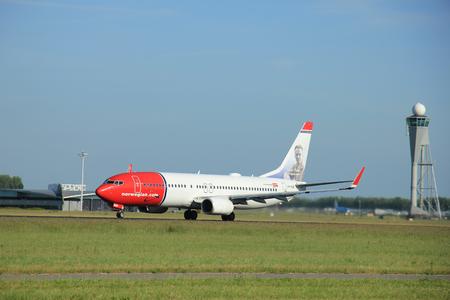 danmark: Amsterdam, the Netherlands - June 9th 2016: LN-NGB Norwegian Air Shuttle Boeing 737-8JP(WL), take off from Polderbaan runway Schiphol, destination Copenhagen, Danmark Editorial