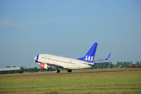 takeoff: Amsterdam the Netherlands - June 9th, 2016: SE-REY SAS Scandinavian Airlines Boeing 737-76N(WL) takeoff from Polderbaan runway, destination Stockholm, Sweden