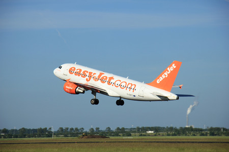 takeoff: Amsterdam the Netherlands - June 9th, 2016: G-EZFT easyJet Airbus A319-111 takeoff from Polderbaan runway, destination Prague, Czech republik Editorial