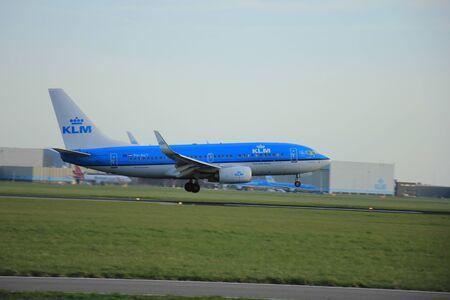 klm: Amsterdam, The Netherlands, april 11, 2015:PH-BGT KLM Royal Dutch Airlines Boeing 737-7K2   approaching runway 09-27 Buitenveldert Editorial