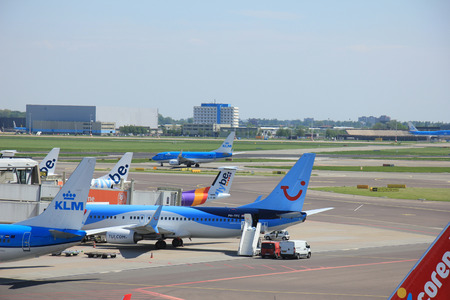 klm: Amsterdam The Netherlands -  May 13th 2016: planes from Fly Be, TUI and KLM parked at gate at Schiphol International Airport Editorial