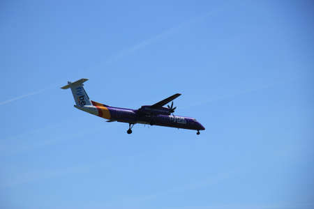 polderbaan: Amsterdam the Netherlands - May, 5th 2016:  G-FLBE Flybe De Havilland Canada DHC-8 approaching Polderbaan runway, arriving from Exeter, United Kingdom