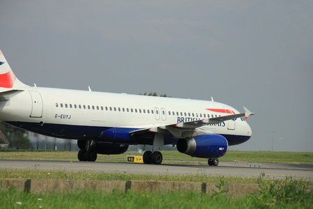 polderbaan: Amsterdam, The Netherlands - August 10 2015: G-EUYJ British Airways Airbus A320-200  taxing on the Polderbaan runway to the main terminal of Amsterdam Schiphol Airport
