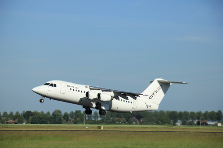 takeoff: Amsterdam, the Netherlands - June 9th 2016: EI-RJE Cityjet British Aerospace Avro RJ85 , takeoff from Polderbaan runway Schiphol, destination London, United Kingdom Editorial