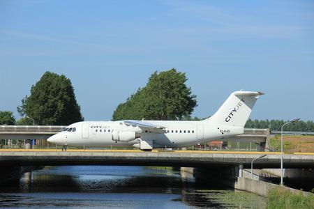 aerospace: Amsterdam, the Netherlands - June 9th 2016: EI-RJD Cityjet British Aerospace Avro RJ85 taxiing to Polderbaan runway Schiphol, destination London, United Kingdom