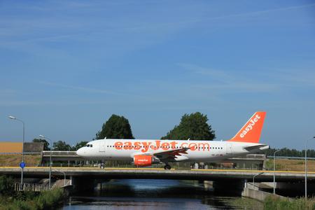 schiphol: Amsterdam, the Netherlands - June 9th 2016: HB-JZY easyJet Switzerland Airbus A320, taxiing to Polderbaan runway Schiphol, destination Geneva, Switzerland Editorial