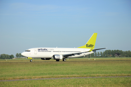 takeoff: Amsterdam the Netherlands - June 9th, 2016: YL-BBL Air Baltic Boeing 737-33V(WL)   takeoff fro Polderbaan runway, destinationRiga, Latvia Editorial