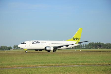 bbl: Amsterdam the Netherlands - June 9th, 2016: YL-BBL Air Baltic Boeing 737-33V(WL)   takeoff fro Polderbaan runway, destinationRiga, Latvia Editorial