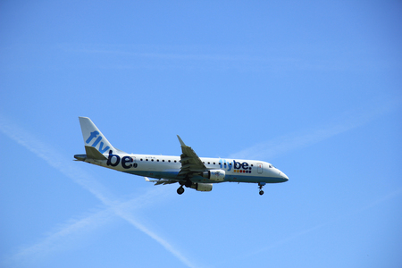 schiphol: Amsterdam the Netherlands - May, 5th 2016:  G-FBJC Flybe Embraer ERJ-175STD  approaching Schiphol Polderbaan runway, arriving from Manchester, United Kingdom
