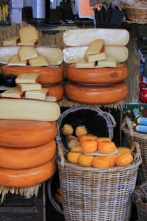 beverage display: Different sorts of Dutch cheese on display in a store Stock Photo