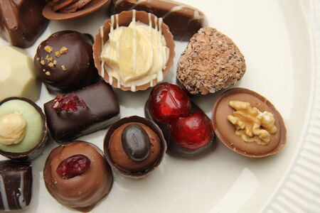 confectionery: Delicious chocolates from Belgium, decorated with nuts and fruits