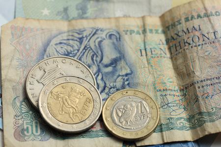 greek coins: Vintage greek Drachma coins on old greek banknotes