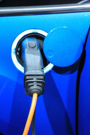hybrid car: Environmental friendly hybrid car on recharge Stock Photo