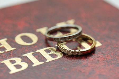 wedding bands: Two diamond wedding bands for a double bride wedding on the cover of the bible Stock Photo