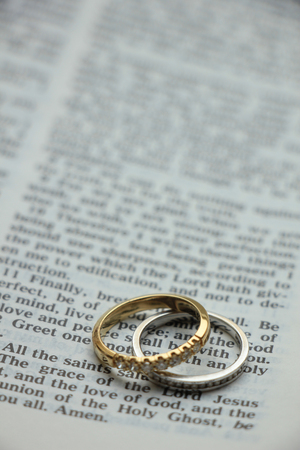 wedding bands: Two diamond wedding bands for a double bride wedding, on a bible verse Stock Photo