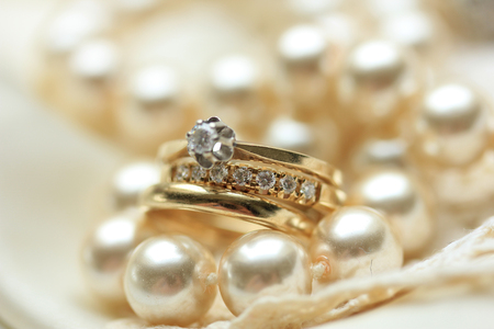 carat: Wedding set in yellow gold: solitaire engagement ring, diamond anniversary band and plain wedding band