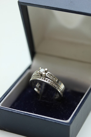 carat: Diamond channel set engagement ring and wedding band in white gold