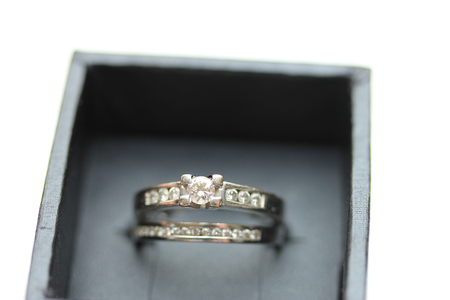 wedding band: Diamond channel set engagement ring and wedding band in white gold