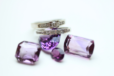 diamond rings: Diamond rings on loose purple amethyst gemstones