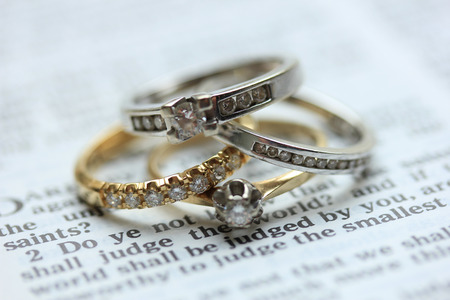 Two wedding sets, one in yellow gold, one in white gold for a double bride wedding on a bible verse