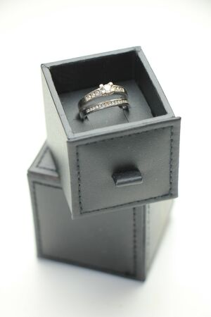 wedding band: Diamond channel set engagement ring and wedding band in white gold in a luxurious ring box