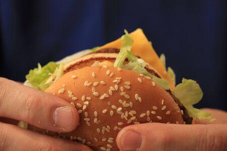 nutricion: Man holding a fresh made hamburger Stock Photo