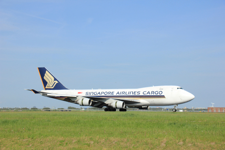 polderbaan: Amsterdam, the Netherlands -  May,11th 2015:9V-SFK Singapore Airlines Cargo Boeing 747-412F on the Polderbaan runway of Amsterdam Schiphol Airport. Editorial