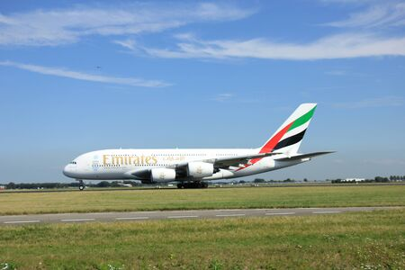 polderbaan: Amsterdam, The Netherlands - August 7 2015: A6-EDI Emirates Airbus A380-800  takes off from Polderbaan Runway.
