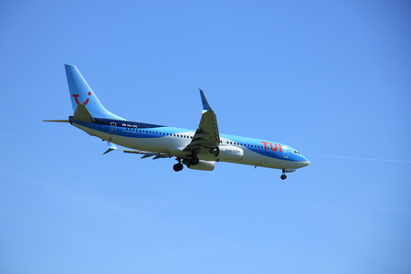 schiphol: Amsterdam the Netherlands - May, 5th 2016: PH-TFC TUI Airlines Netherlands Boeing 737 approaching Schiphol Polderbaan runway, arriving from Funchal, Amsterdam Editorial