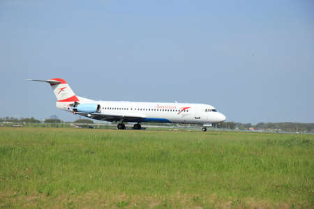 11th: Amsterdam, the Netherlands -  May,11th 2015: OE-LVD Austrian Airlines Fokker F100 on the Polderbaan runway.
