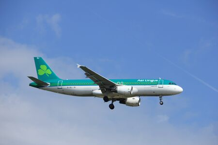 Amsterdam, the Netherlands - July 21st 2016: EI-DEJ Aer Lingus Airbus A320-214, approaching Polderbaan runway at Schiphol Amsterdam Airport, arriving from Dublin, Ireland Editorial