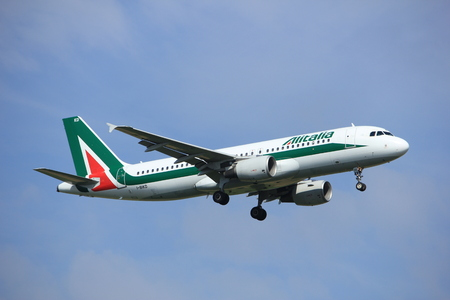 Amsterdam, the Netherlands - July 21st 2016: I-BIKD Alitalia Airbus A320, approaching Polderbaan runway at Schiphol Amsterdam Airport, arriving from Rome, Italy