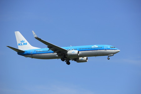 klm: Amsterdam, the Netherlands - July 21st 2016: PH-BGC KLM Royal Dutch Airlines Boeing 737,  approaching Polderbaan runway at Schiphol Amsterdam Airport, arriving from Manchester, United Kingdom