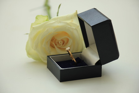 rose ring: Classic solitaire engagement ring in box and white rose