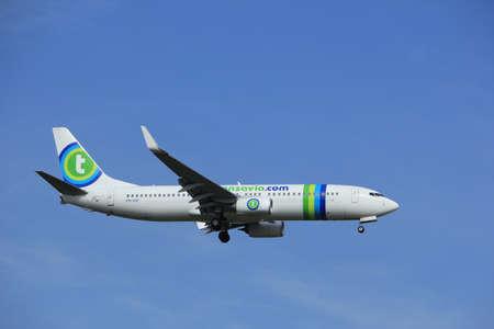 polderbaan: Amsterdam, the Netherlands - July 21st 2016: PH-HSF Transavia Boeing 737,  approaching Polderbaan runway at Schiphol Amsterdam Airport, arriving from Girona, Spain