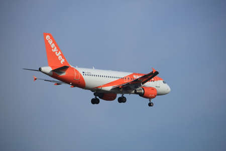 Amsterdam, the Netherlands - July 21st 2016: G-EZFG   easyJet Airbus A319-111, approaching Polderbaan runway at Schiphol Amsterdam Airport, arriving from Liverpool