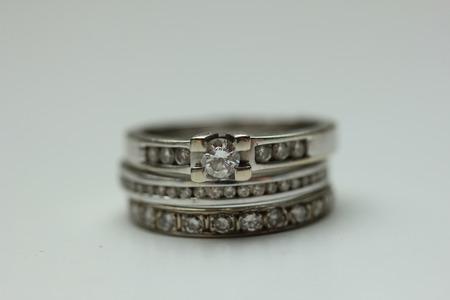 wedding band: Diamond ring stack: engagement ring, wedding band and anniversary band Stock Photo