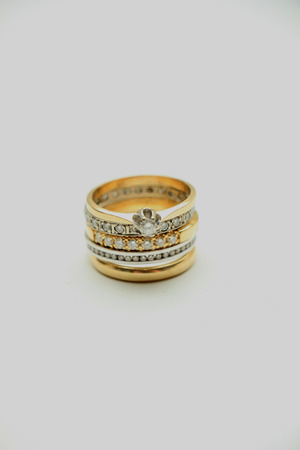 diamond rings: Stacked diamond rings in white and yellow gold Stock Photo