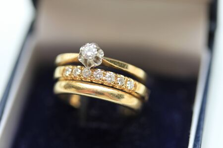 wedding band: Wedding set in yellow gold: solitaire engagement ring, diamond anniversary band and plain wedding band