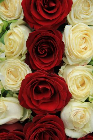 centerpiece: Red and whte roses in a wedding centerpiece Stock Photo