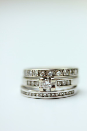 carat: Diamond ring stack: engagement ring, wedding band and anniversary band Stock Photo