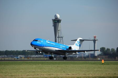 Amsterdam, the Netherlands  - August, 18th 2016: PH-KZU  KLM Cityhopper Fokker F70,  taking off from Polderbaan Runway Amsterdam Airport Schiphol Editorial