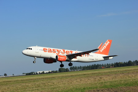 schiphol: Amsterdam, the Netherlands  - August, 18th 2016: G-EZWT easyJet Airbus A320-214  taking off from Polderbaan Runway Amsterdam Airport Schiphol