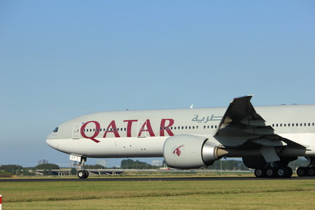 schiphol: Amsterdam, the Netherlands  - August, 18th 2016: A7-BAY Qatar Airways Boeing 777,  taking off from Polderbaan Runway Amsterdam Airport Schiphol