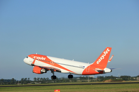 schiphol: Amsterdam, the Netherlands  - August, 18th 2016: G-EZPA easyJet Airbus A320-214,  taking off from Polderbaan Runway Amsterdam Airport Schiphol