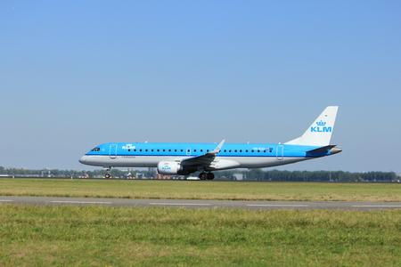 polderbaan: Amsterdam, the Netherlands  - August, 18th 2016: PH-EZU KLM Cityhopper Embraer ERJ-190STD   taking off from Polderbaan Runway Amsterdam Airport Schiphol