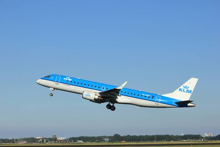 klm: Amsterdam, the Netherlands  - August, 18th 2016: PH-EZW  KLM Cityhopper Embraer ERJ-190STD   taking off from Polderbaan Runway Amsterdam Airport Schiphol Editorial