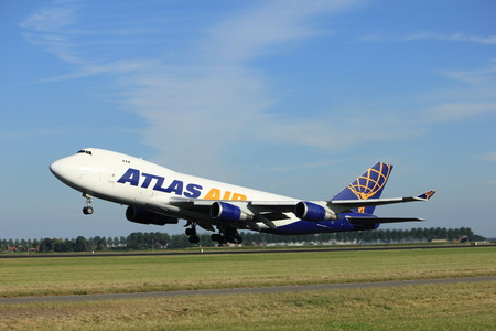 boeing 747: Amsterdam, the Netherlands  - August, 18th 2016: N496MC Atlas Air Boeing 747-47UF,  taking off from Polderbaan Runway Amsterdam Airport Schiphol