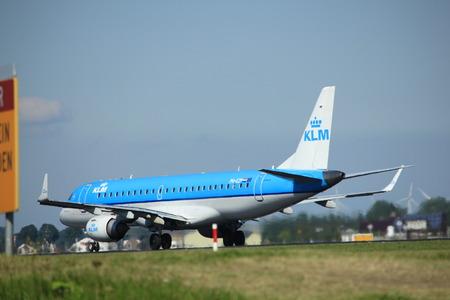 schiphol: Amsterdam, the Netherlands  - August, 18th 2016: PH-EZP KLM Cityhopper Embraer ERJ-190STD   taking off from Polderbaan Runway Amsterdam Airport Schiphol