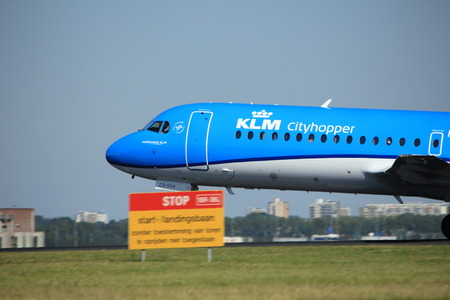klm: Amsterdam, the Netherlands  - August, 18th 2016: PH-KZD KLM Cityhopper Fokker F70,  taking off from Polderbaan Runway Amsterdam Airport Schiphol